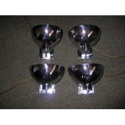 A magnificent set of (4) chrome Art Deco wall lights in the style of Jean Perzel