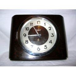 Excellent oxblood coloured bakelite wall clock by Bayard