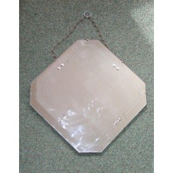 Square mirror with cropped corners hung as a diamond