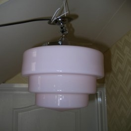 Pair of stepped pink odeon style ceiling fixtures
