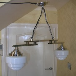 Two arm modernist chrome fixture with stepped white shades