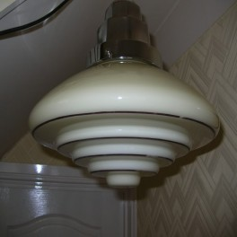 Large cream stepped glass fixture in the bauhaus taste