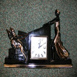 Superb pottery clock set -lady and borzois by odyv in black with silver decoration - some restoration but a very rare colour