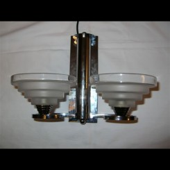 French modernist pair of chrome wall lights with stepped shades