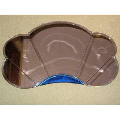 Superb English Art Deco cloud shaped mirror in rose coloured glass with blue contrast glass