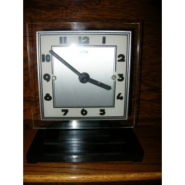 Excellent glass and Bakelite Modernist clock by Leon Hatot