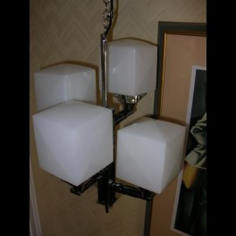 Modernist square section (4) arm fixture with white cube shades