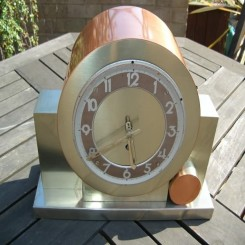 Modernist bronze pendulum clock