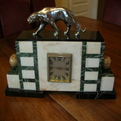 Chrome bronze panther on marble clock with (8) day movement