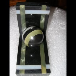 Pair of modernist ball book ends in black marble & green/white onyx