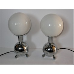 pair of atomic futuristic chrome table lamps with white globe shades
