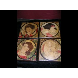 A lovely set of wooden wall plaques depicting the four seasons hand painted